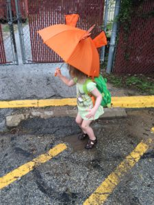 She didn't want to get wet while puddle jumping!
